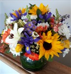 Deliver a variety of colourful flowers in a terracotta bowl - Click to enlarge